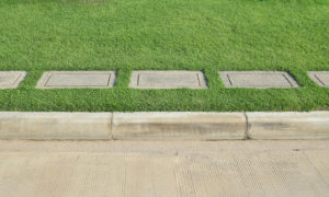 Gravel texture and strip grass with concrete road as background